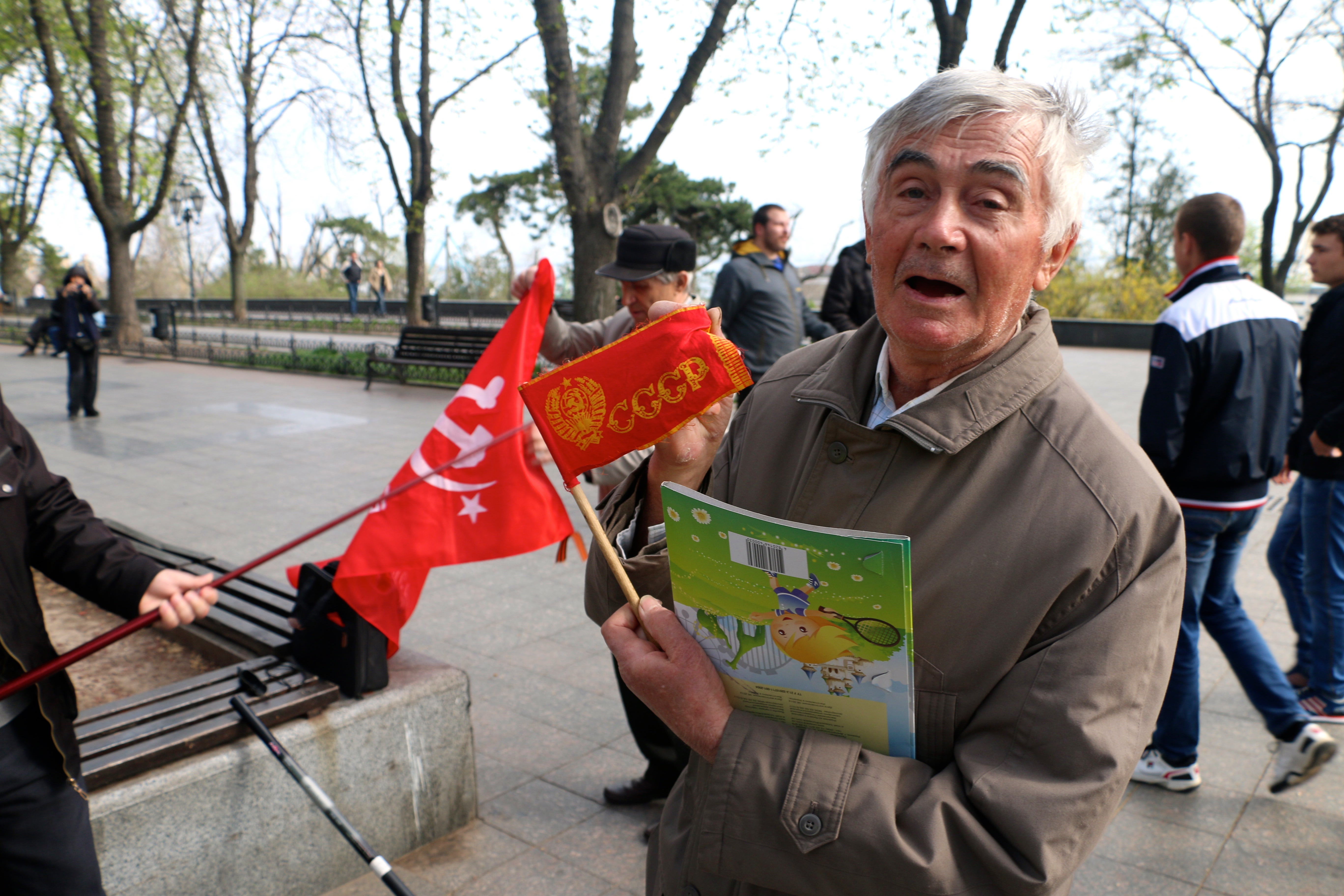 A Communist Party member with a Soviet flag in Odessa, Ukraine. (Photo: Nolan Peterson/The Daily Signal)