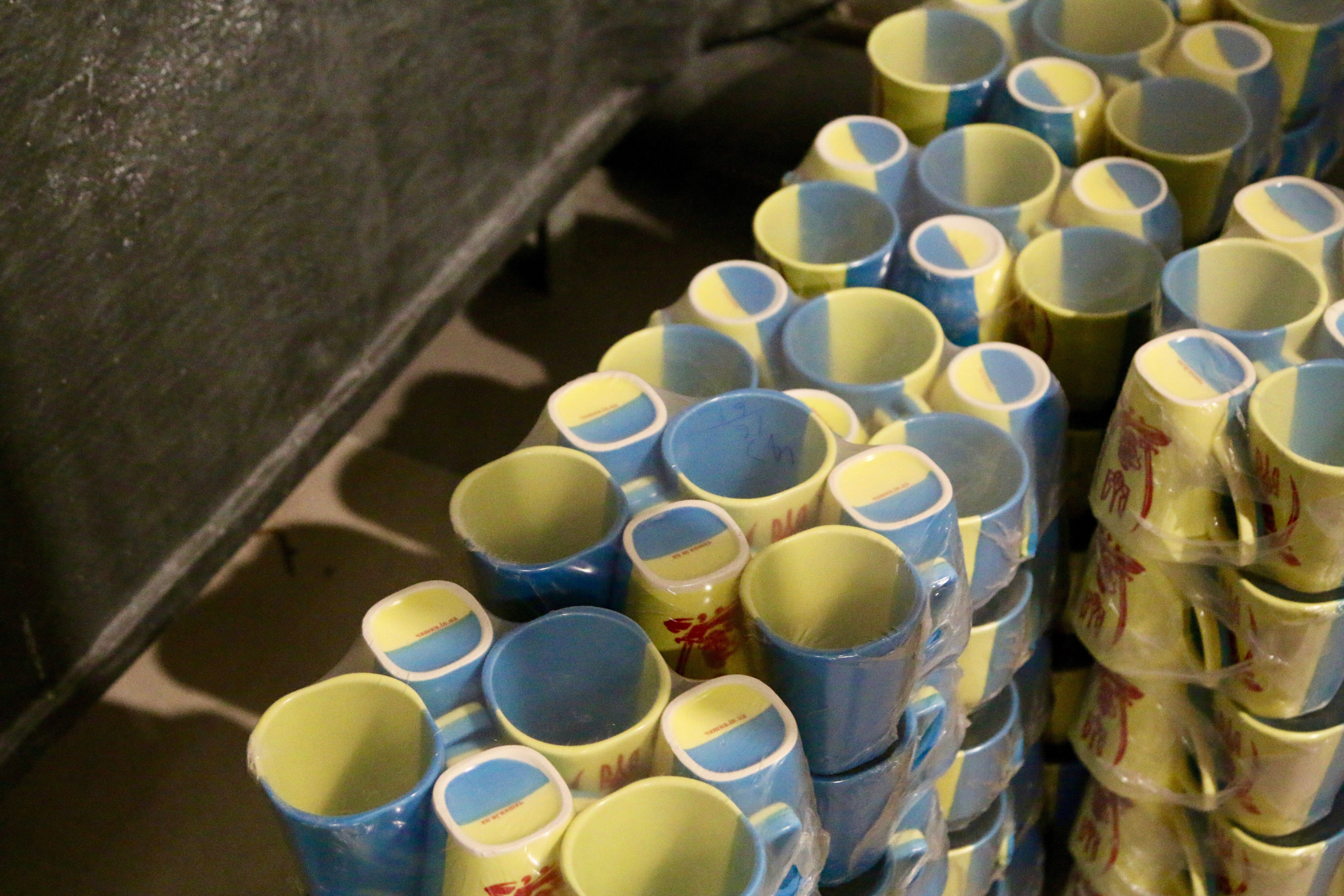 Olexandr Ivanovich Poligenko's blue and yellow coffee mugs—Ukraine's national colors—have become ubiquitous throughout the war zone.