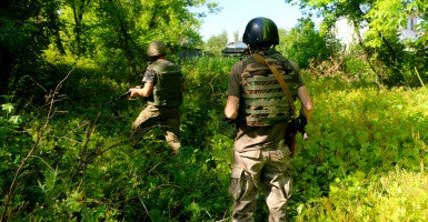 Ukrainian soldiers on patrol in Pisky. (Photo: Nolan Peterson/The Daily Signal)