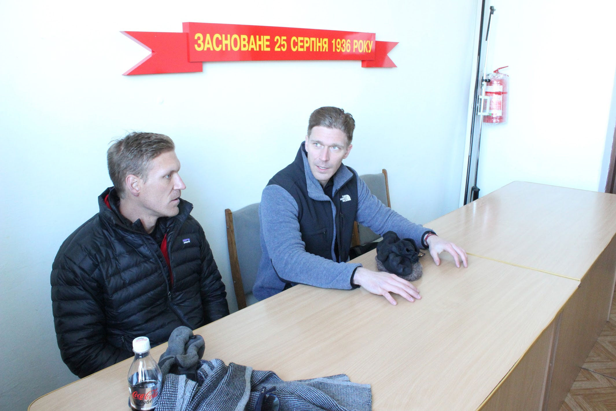 The author, right, and his brother speaking to officials in Kurakhovo, Ukraine. (Photo: Adrian Bonenberger)