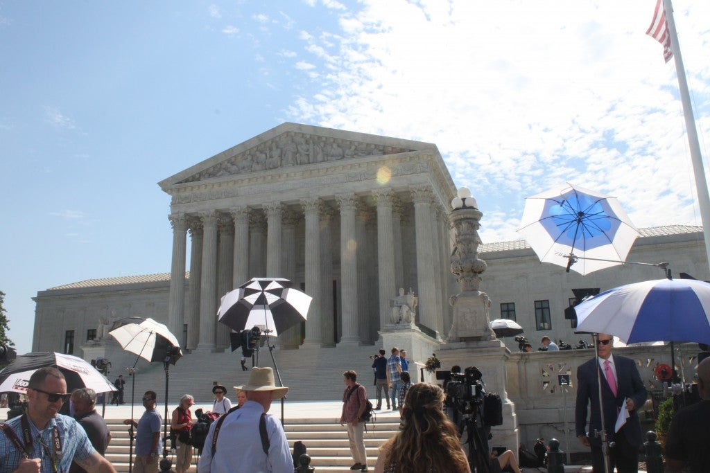 News stations begin to set up waiting for a Supreme Court decision. (Photo: Samantha Reinis/The Daily Signal)