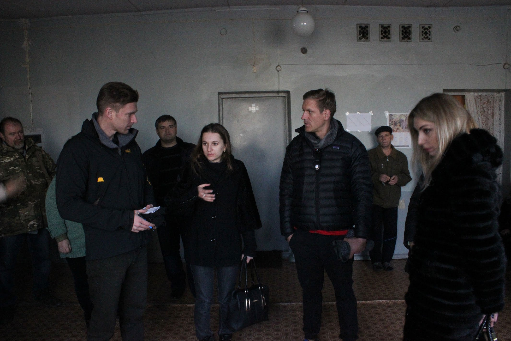 The author and his brother speaking with Ukrainians displaced by the war at a shelter in the eastern Ukrainian town of Kurakhovo. (Photo: Adrian Bonenberger)