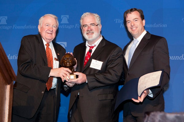 "Kevin ""Seamus"" Hasson (center), founder of the Becket Fund for Religious Liberty, receives the Salvatori Prize from Heritage's Edwin Meese III (left) and Matthew Spalding. Photo:  Shealah Craighead/The Heritage Foundation"