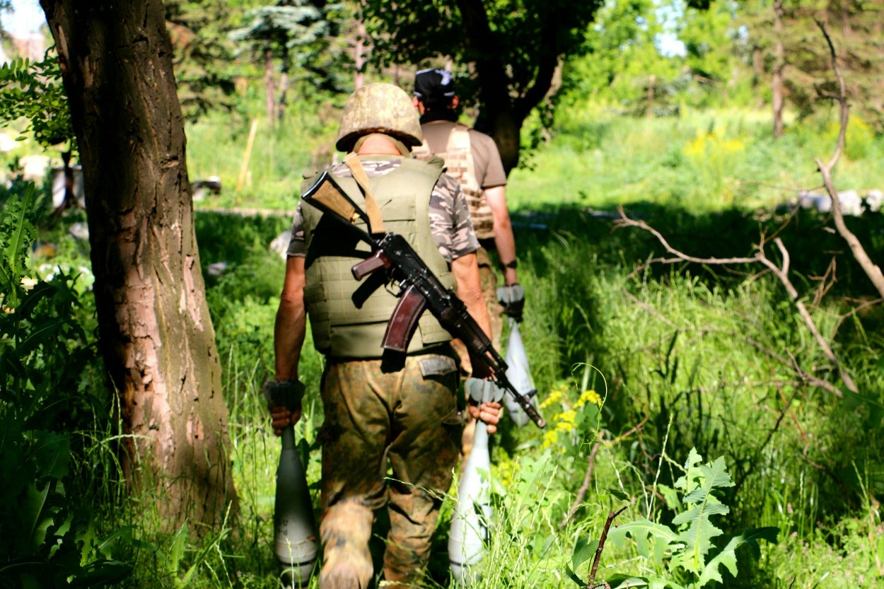 Ukrainian soldiers on patrol in eastern Ukraine's war zone.