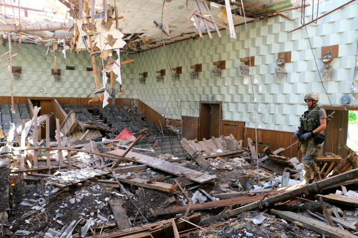Konstantin Bernatovich inside a school destroyed by artillery. (Photo: Nolan Peterson/The Daily Signal)
