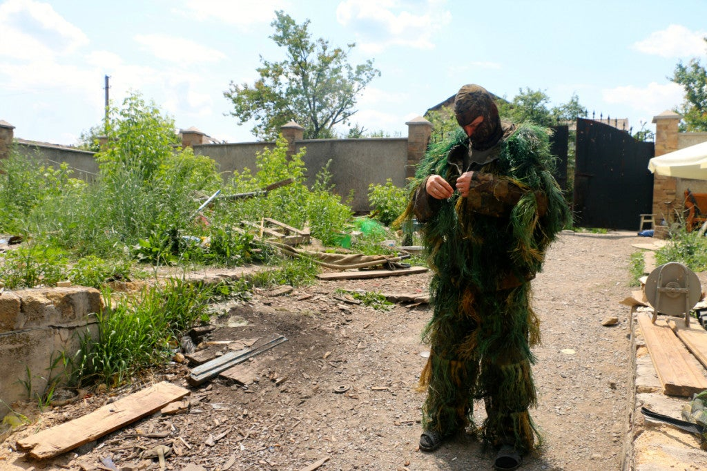 Volodymyr, a Ukrainian sniper, preparing for a mission in Pisky. (Photo: Nolan Peterson/The Daily Signal)