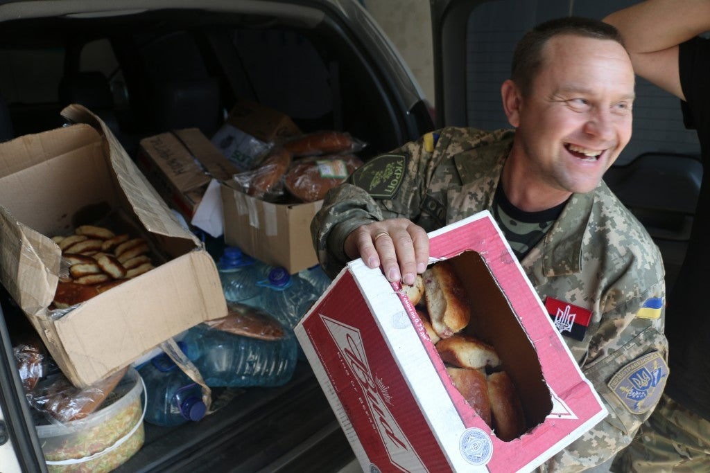 Oleg Gurbanov, 47, a civilian volunteer delivering supplies to soldiers in Pisky. (Photo: Nolan Peterson/The Daily Signal)