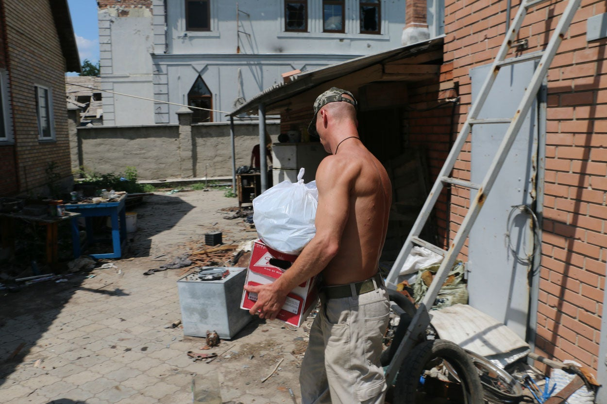 Nemo unloads food civilian volunteers delivered to front-line units in Pisky. (Photo: Nolan Peterson/The Daily Signal)
