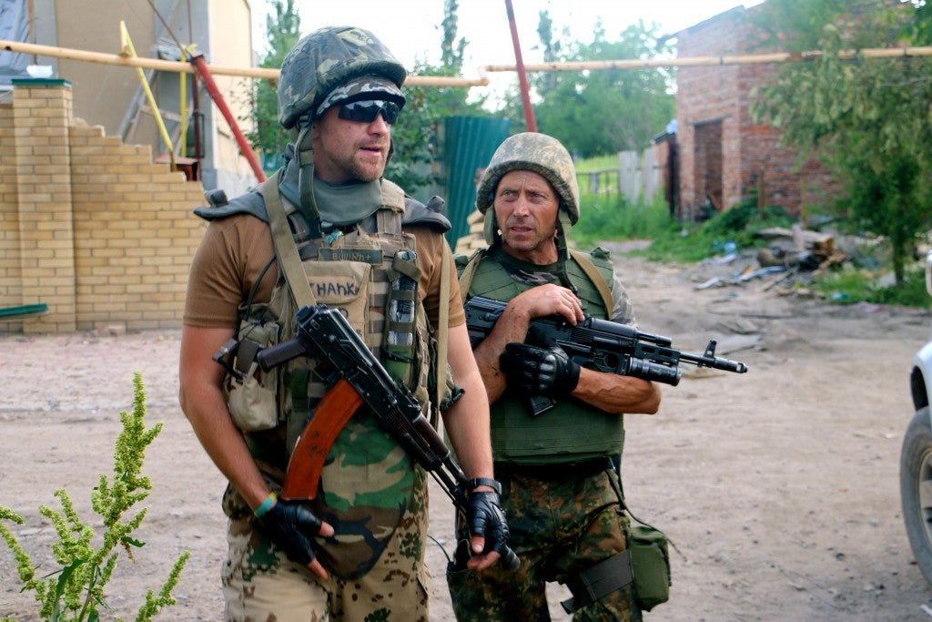 Vasiliy Ivaskiv, 53, (right), and another soldier on patrol in Pisky. (Photo: Nolan Peterson/The Daily Signal)