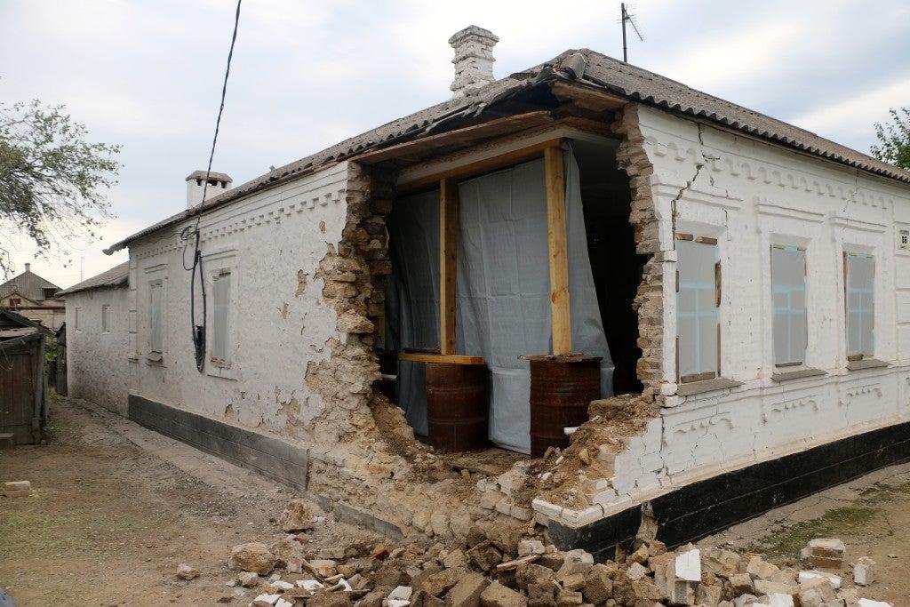 Artillery damage to Nina Konstantinovna's home was extensive. (Photo: Nolan Peterson/The Daily Signal)