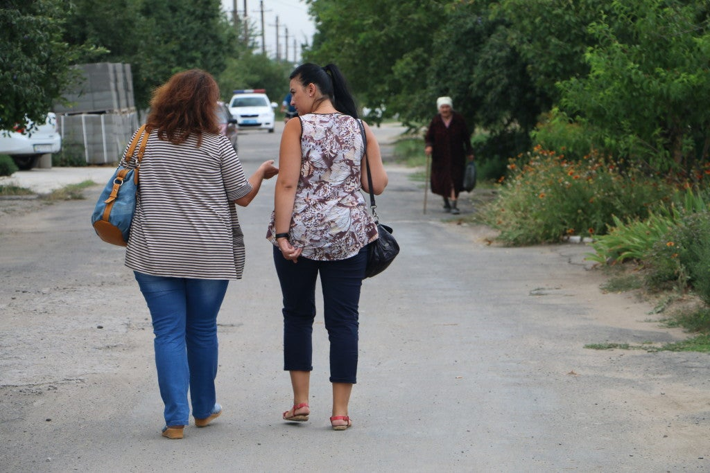 Life goes on in Sartana, Ukraine, only days after an artillery attack killed three. (Photo: Nolan Peterson/The Daily Signal)