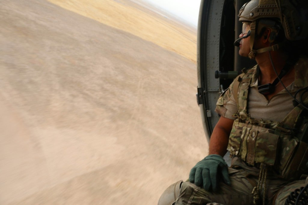 An Air Force pararescueman on a helicopter flight over Iraq. (Photo: Nolan Peterson/The Daily Signal)