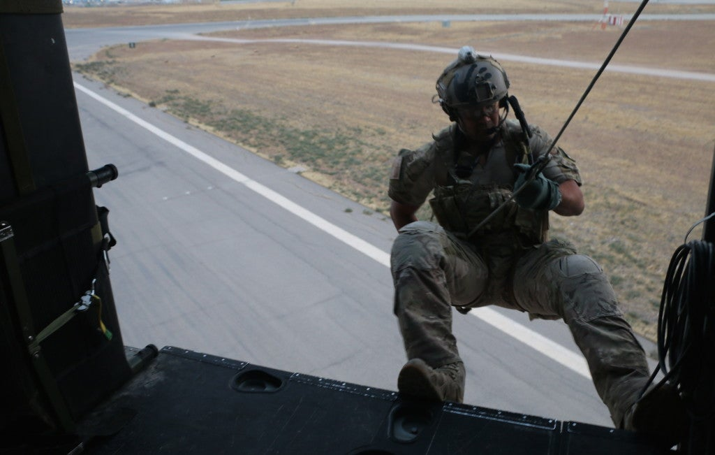An Air Force pararescueman rappels out of a helicopter in Iraq. (Photo: Nolan Peterson/The Daily Signal)