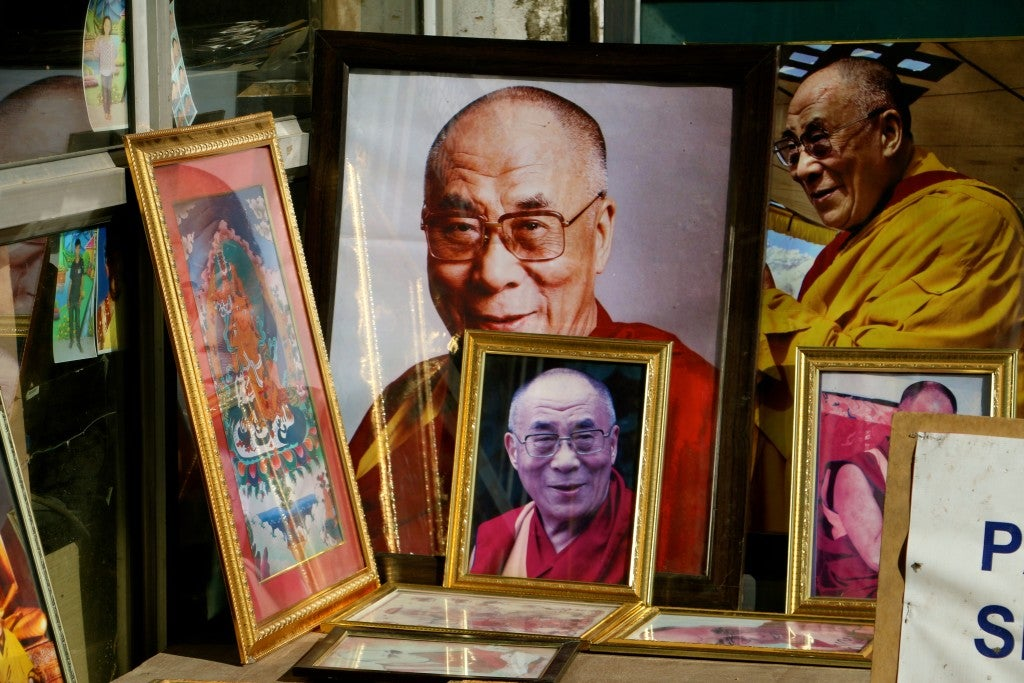 Images of the Dalai Lama, which are ubiquitous among Tibetan refugee colonies, in a shop in Leh. (Photo: Nolan Peterson/The Daily Signal)