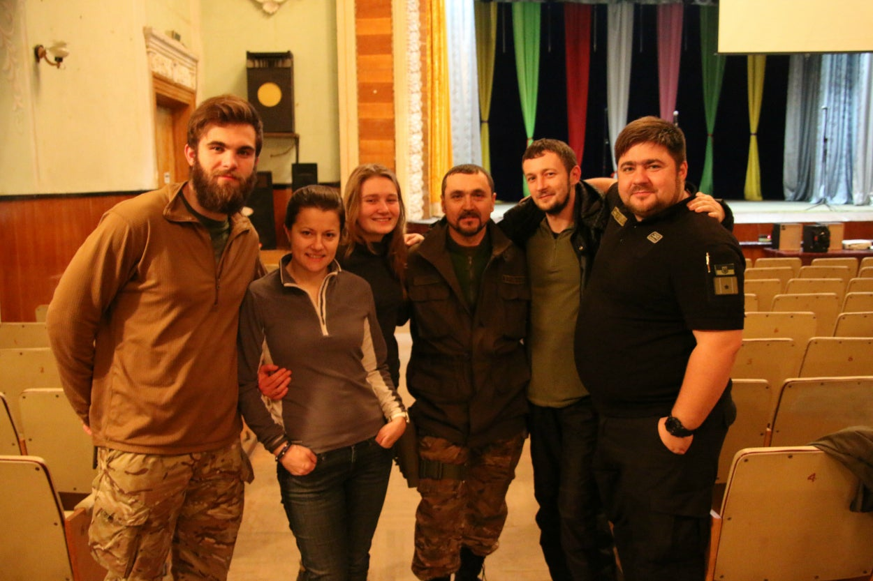 "A volunteer team of Ukrainian civilian psychologists and war veterans from the project ""Sector V"" gather on a trip to the front lines to counsel deployed soldiers about symptoms of post-traumatic stress."