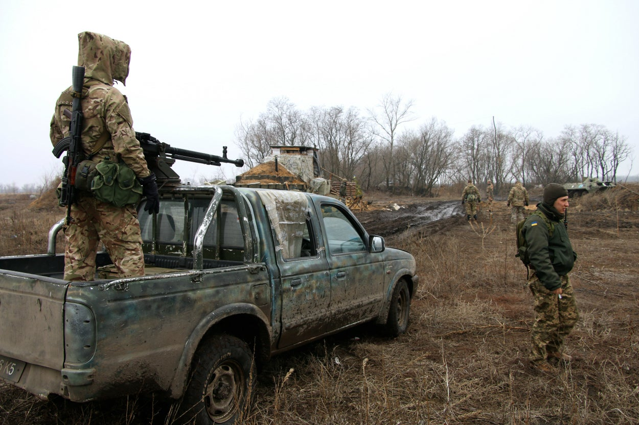 Ukrainian military vehicles never travel alone through no man's land; soldiers are always armed and ready to fight off an ambush. (Photos: Nolan Peterson/The Daily Signal)
