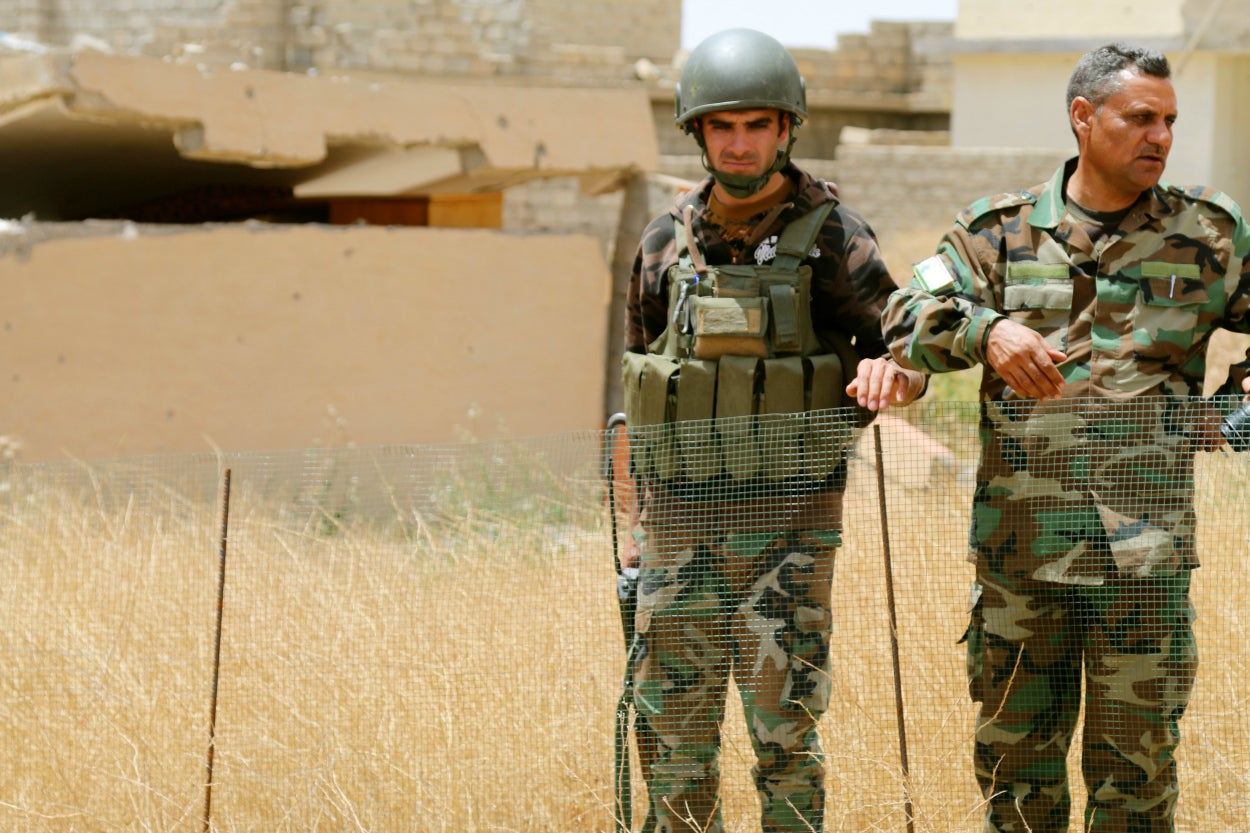 Even battle-hardened peshmerga soldiers seem affected by the mass graves in Sinjar.