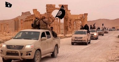 ISIS fighters pictured driving through Syria (Photo: News Pictures / Polaris/Newscom)