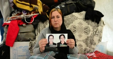 November 15, 2014 - Sharia, Kurdistan, Iraq: Hayat, 38, at a refugee camp, from the Yazidi religious minority, shows a picture of her two daughters. The daughters, Wahid, 18, and Riwaz, 14, were captured by Islamic State militants (ISIS) (Photo: Alfred Yaghobzadeh/Polaris/Newscom)