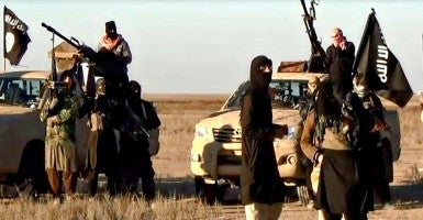 Feb. 10, 2015 - Raqqa, Syria - Islamic State of Iraq and the Levant fighters with vehicles and armed in the desert as shown in propaganda video released by the militants. (Photo: Ho/ZUMA Press/Newscom)
