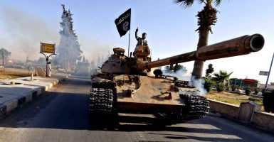 Islamic State of Iraq and the Levant fighters during a military parade in Raqqa province in Syria June 30, 2014 (Photo: Ho/ZUMA Press/Newscom)