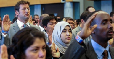 New U.S. citizens take the Oath of Allegiance during an Independence Day naturalization ceremony this year in Seattle, Washington. (Photo: David Ryder /Reuters/Newscom)