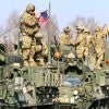A U.S. Army Stryker armored fighting vehicle convoy prepares to enter P