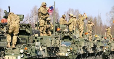 A U.S. Army Stryker armored fighting vehicle convoy prepares to enter Poland on March 24 as part of Operation Dragoon Ride. (Photo: Nolan Peterson/The Daily Signal)