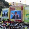 Supporters of Hezbollah leader Sayyed Hassan Nasrallah rally August 14 on the 9th anniversary of the end of Hezbollah's 2006 war with Israel. Hezbollah is supported by Iran. (Photo: STR/EPA/Newscom)