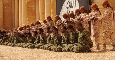 ISIS released a video showing 25 Syrian government soldiers being executed by teenagers in the ancient amphitheater in the city of Palmyra.  (Photo: News Pictures/ Polaris/Newscom)