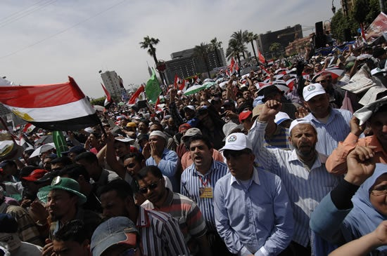 April 20, 2012 - Cairo, Egypt - Egyptian Islamist and Liberal parties march together into Tahrir Square for the first time since early in the revolution.
