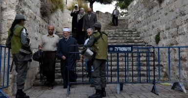Israeli border police check Palestinians on their way to pray at the Al Aqsa Mosque at a checkpoint outside the Old City of Jerusalem, Oct. 9, 2015. (Photo: Debbie Hill/UPI/Newscom)