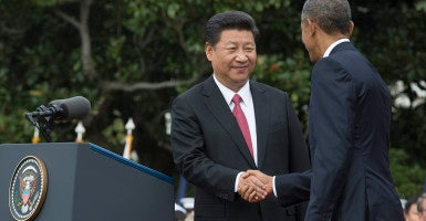 President Barack Obama and President of China Xi Jinping shake hands during a welcome ceremony on the South Lawn of the White House, in Washington, DC, September 2015.(Photo EPA/Michael Reynolds /Newscom)