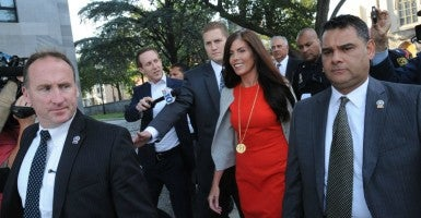 Embattled Pennsylvania Attorney General Kathleen Kane walks out of the Montgomery County Courthouse in Norristown, Pa., surrounded by her security detail on Monday, Aug. 24, 2015, after a preliminary hearing on charges against her including perjury, false swearing and obstruction of justice. (Clem Murray/Philadelphia Inquirer/TNS/Newscom)