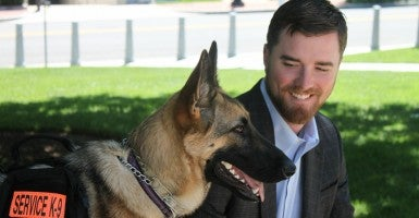 Former Marine Corporal Cole T. Lyle and his miracle service dog Kaya. (Photo: Chelsea Scism/The Daily Signal)