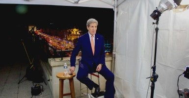 U.S. Secretary of State John Kerry sits above the Arc de Triomphe in Paris, France, on Dec. 13, 2015, before taping a series of four Sunday news program interviews following the COP21 climate change conference. (Photo: State Department photo/SIPA/Newscom)