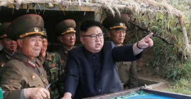 North Korean leader Kim Jong Un and missiles