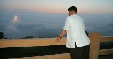 "North Korean leader Kim Jong-un witnesses the launch of a ballistic missile. The North's official Korean Central News Agency reported on June 30, 2014, that Kim ""guided a tactical rocket firing drill,"" adding that during the drill there was a precision-guided missiles launch and firing of shells. The report did not specify the details on the time and place of the launches, but the South Korean military said the North fired two short-range missiles into the East Sea earlier in the day. (Photo: Yonhap News/YNA/Newscom)"