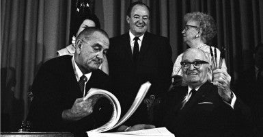LBJ's Great Society programs. President Lyndon Johnson signing the Medicare Bill with former president Harry Truman, the first president to advocate for government health insurance for the elderly. Standing behind are Lady Bird Johnson, Hubert Humphrey and Bess Truman. July 7, 1965. (Photo: Everett Collection/Newscom)