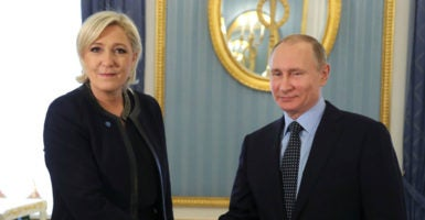 French presidential contender and leader of National Front Marine Le Pen and Russian President Vladimir Putin shake hands during a meeting in Moscow, March 24, 2017. (Photo: Klimentyev Mikhail/ZUMA Press/Newscom)