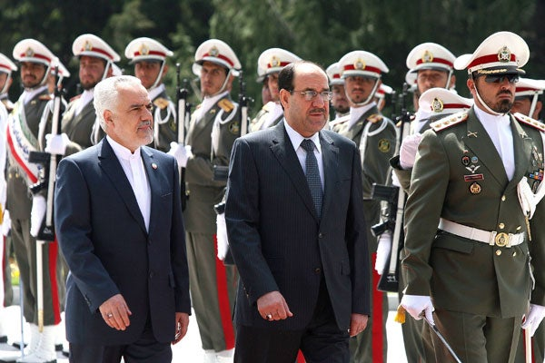 Iran's First Vice President Mohammad Reza Rahimi (L) and visiting Iraqi Prime Minister Nouri Al Maliki review the Honour Guards in Tehran in April.