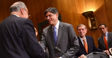 Treasury Secretary Lew shakes hands with Sen. Charles Schumer, D-N.Y. (Photo:KEVIN DIETSCH/UPI/Newscom)