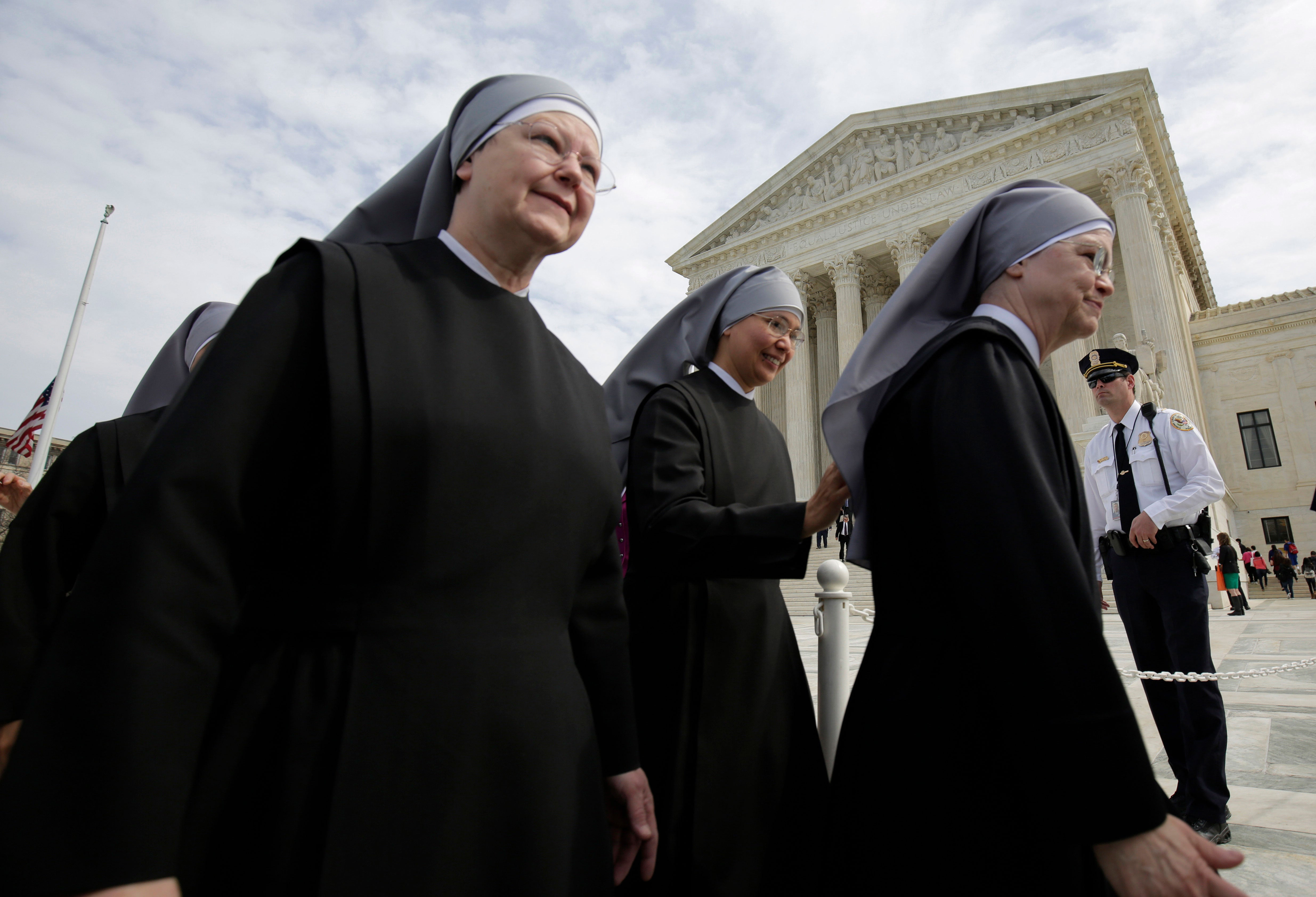 Nuns with Little Sisters of the Poor walk outside the ground of the Supreme Court after arguments were heard in Zubik v. Burwell, March 23, 2016. (Photo: Joshua Roberts/Reuters/Newscom)