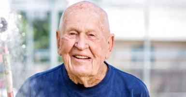 103-year-old Loren Wade waters plants at a Kansas Walmart. (Photo: Walmart)