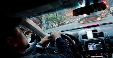 Manhattan, New York, U.S. - A pink mustache on the dashboard as Bouchaib El Hassani, 31, a Lyft driver, makes his way through midtown (Photo: Bryan Smith/ZUMA Press/Newscom)