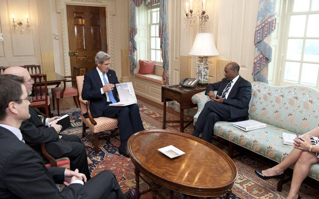 U.S. Secretary of State John Kerry meets with Daniel Yohannes, CEO of the Millennium Challenge Corporation (State Department/Sipa USA/Newscom)