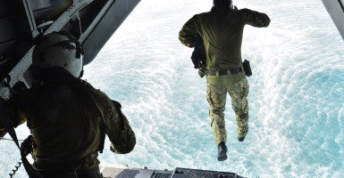 Sept. 29, 2015 - Arabian Sea, United States of America - U.S. Navy Explosive ordnance disposal commandos jump from the back of a helicopter during training operations September 29, 2015 in the Arabian Sea. (Photo: Jonah Z. Stepanik/Planet Pix via ZUMA Wire / Newscom)