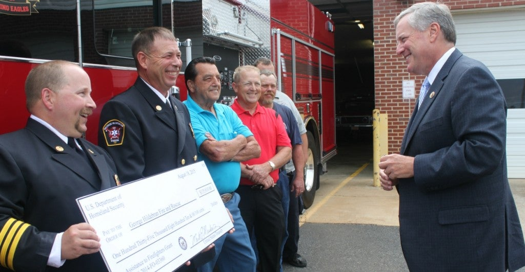 "Meadows presents a $153,881 grant from the Federal Emergency Management Agency to George Hildebran Fire and Rescue. ""We got your back,"" Meadows says. (Photo: Josh Siegel/The Daily Signal)"