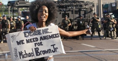 A protester makes her voice heard as a march organized by area ministers makes its way through Ferguson, Mo., on Wednesday, Aug. 13. (Photo: J.B. Forbes/St. Louis Post-Dispatch/MCT)