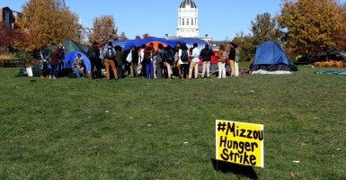 Students gather on the University of Missouri campus to show support for Jonathan L. Butler, a 25-year-old graduate student who held a hunger strike for seven days, until his university president resigned.  (Photo: Bill Greenbklatt/UPI/Newscom)